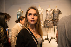 Beautiful woman visiting fashion dresses exhibition in museum Stock Images