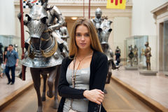 Beautiful woman visiting museum during vacation trip.  Royalty Free Stock Photos
