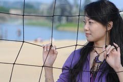 beautiful woman and volleyball net Stock Photography