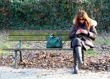 Beautiful woman waiting on the bench Stock Photos