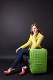 Beautiful woman waiting with a big baggage Stock Photography