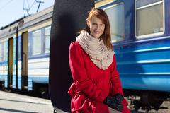 Beautiful woman waiting for train on the platform Stock Photo