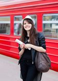 Woman waiting for a train with ticket in her hands Stock Images
