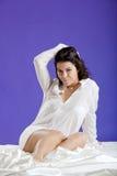 Beautiful woman waking up Stock Image