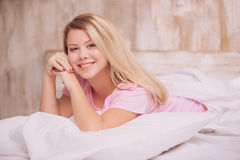 Beautiful woman waking up in the bed Royalty Free Stock Images