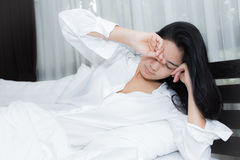 Beautiful woman waking up in her bed Royalty Free Stock Photos