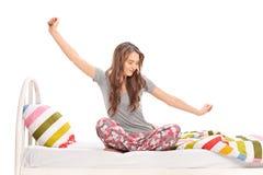 Beautiful woman waking up and stretching Royalty Free Stock Photo