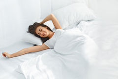 Beautiful woman waking up Royalty Free Stock Photography