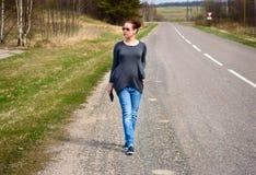 Beautiful woman on the walk. Closeup of beautiful woman walking around stock photo