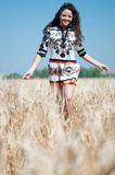 Beautiful woman walk in wheat field Royalty Free Stock Images