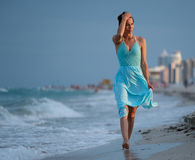 Beautiful woman walking along the South beach, Miami. Royalty Free Stock Photo