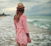 Beautiful woman walking along the South beach, Miami Royalty Free Stock Images