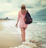 Beautiful woman walking along the South beach, Miami Royalty Free Stock Photos
