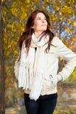 Beautiful woman walking through  autumn  park Stock Images