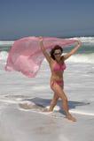 Beautiful woman walking on the beach Royalty Free Stock Photography