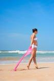Beautiful woman walking at the beach Royalty Free Stock Photography