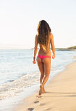Beautiful woman walking on the beach Stock Photos