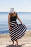 Beautiful woman walking on the beach Stock Photo