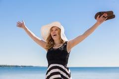 Beautiful woman walking on the beach Stock Image