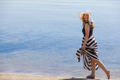 Beautiful woman walking on the beach Royalty Free Stock Photography
