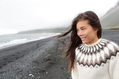 Beautiful woman walking on beach on Iceland Stock Photos