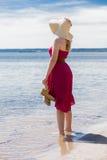 Beautiful woman walking on the beach Stock Photos