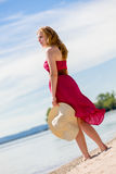 Beautiful woman walking on the beach Royalty Free Stock Image