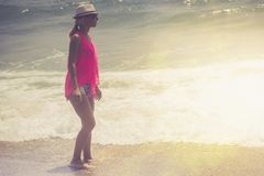 Beautiful woman walking on the beach.Relaxed woman breathing fresh air,emotional sensual woman near the sea, enjoying summer.Trave royalty free stock images