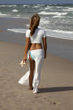 Beautiful woman walking on beach Royalty Free Stock Image