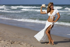Beautiful woman walking on beach Royalty Free Stock Images