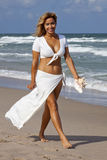 Beautiful woman walking on beach Royalty Free Stock Photos