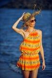 Beautiful woman walking on the beach Royalty Free Stock Photos