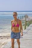 Beautiful Woman walking on a Cayman Island Dock Royalty Free Stock Image