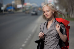 Beautiful woman walking on a city street Royalty Free Stock Images