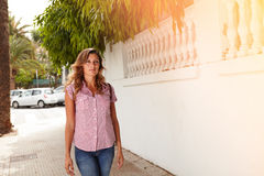 Beautiful woman walking with confidence outdoors Stock Photo
