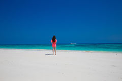 Beautiful woman walking on exotic beach, brunette girl model in Royalty Free Stock Images