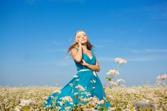 Beautiful woman walking on flower field Royalty Free Stock Images