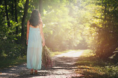Beautiful woman walking forest path. In soft light. Peace and harmony Stock Photo