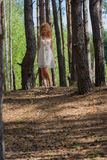 Beautiful woman walking in forest Stock Image