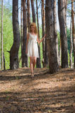 Beautiful woman walking in forest Royalty Free Stock Photography
