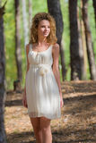 Beautiful woman walking in forest Stock Photos