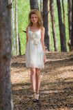 Beautiful woman walking in forest Royalty Free Stock Images