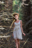 Beautiful woman walking in forest Royalty Free Stock Photos