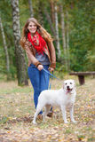 Beautiful woman walking with her dog Stock Image
