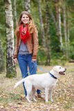 Beautiful woman walking with her dog Stock Images