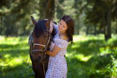 Beautiful woman walking with a horse Royalty Free Stock Images