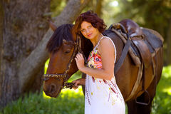 Beautiful woman walking with a horse Royalty Free Stock Image