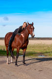 Beautiful woman walking with horse Stock Photos