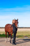 Beautiful woman walking with horse Royalty Free Stock Images