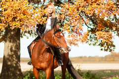 Beautiful woman walking with horse Stock Photography